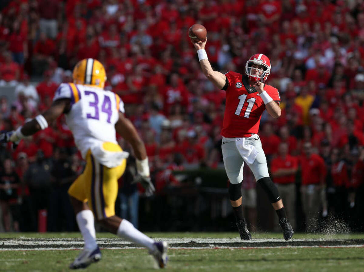 University of Georgia quarterback Aaron Murray (11) attempts a pass during the first half of an NCAA football game against LSU on Saturday, Sept. 26, 2013, in Athens, Ga. (AP Photo/Atlanta Journal-Constitution, Jason Getz)