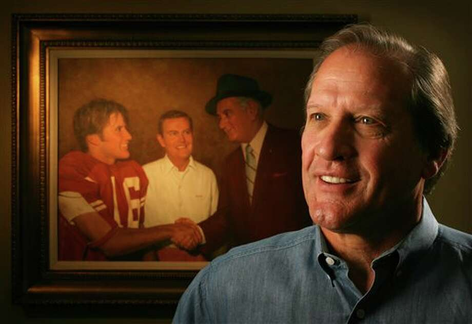 n this Dec. 23, 2005 photo, former Texas quarterback James Street is photographed in his Austin, Texas office. Behind him is a painting of him being congratulated by President Lyndon B. Johnson after the Notre Dame game in 1970. Street, who took over the Longhorns' wishbone offense and led them to the 1969 national championship, has died. He was 65. Serena Fitchard of the James Street Group said Street died early Monday, Sept. 30, 2013. (AP Photo/Statesman.com, Jay Janner) AUSTIN CHRONICLE OUT, COMMUNITY IMPACT OUT, INTERNET MUST CREDIT PHOTOGRAPHER AND STATESMAN.COM Photo: Jay Janner / Statesman.com