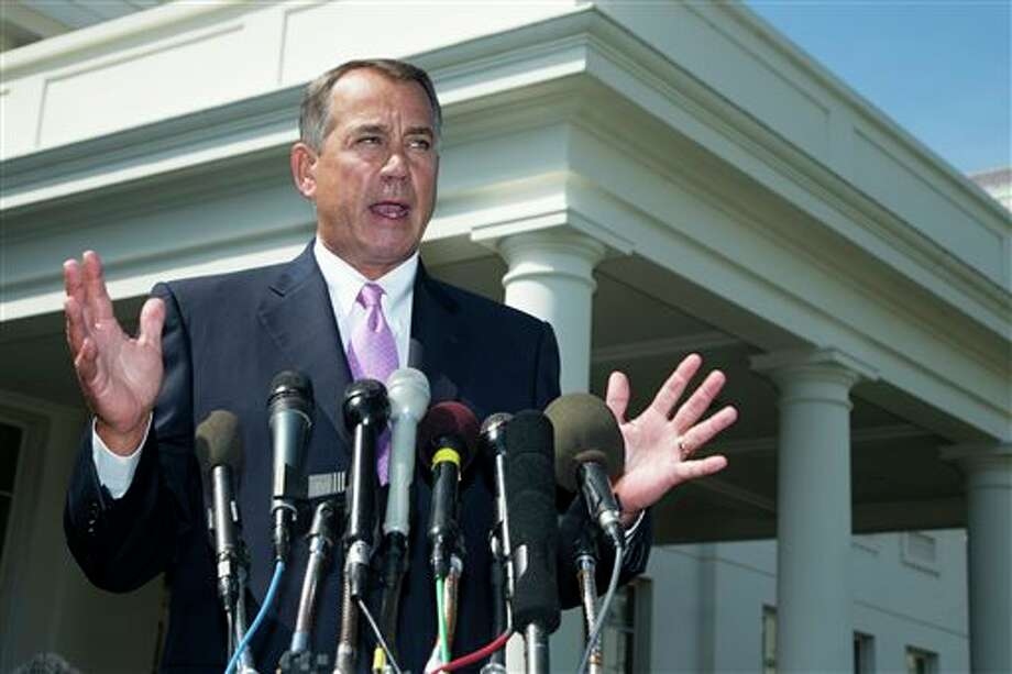 "FILE - In this Sept. 3, 2013, file photo House Speaker John Boehner of Ohio speaks to reporters outside the White House in Washington. As lawmakers end their five-week recess, no member of Congress is in a tighter spot than Boehner, who risks seeing most of his Republican colleagues vote against him on three major issues, Syria, the debt limit, and immigration reform. More than a third of House Republicans have urged Boehner to trigger a government shutdown rather than fund the implementation of ""Obamacare"". (AP Photo/Manuel Balce Ceneta, File) Photo: Manuel Balce Ceneta / A2013"