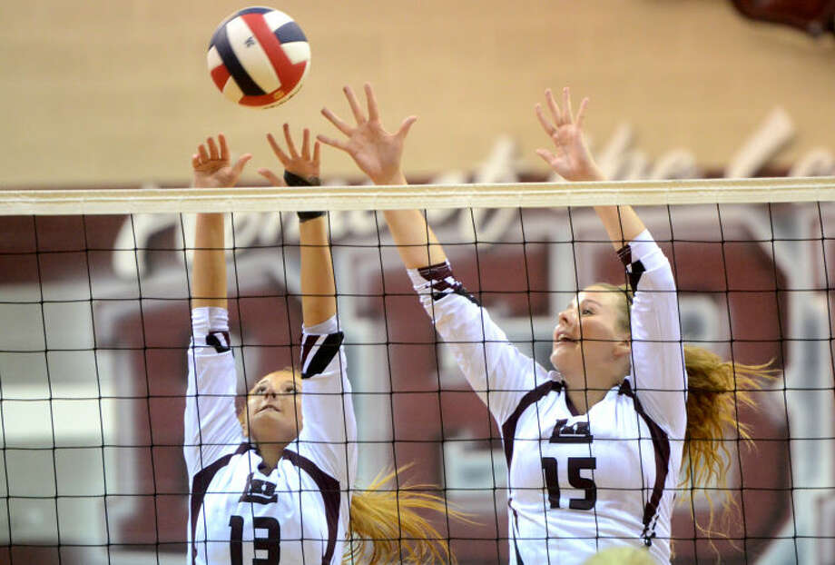 Lee's Tori Jordan (13) and Tessa Bane (15) try to block a hit from San Angelo Central on Tuesday at Lee High School. James Durbin/Reporter-Telegram Photo: JAMES DURBIN
