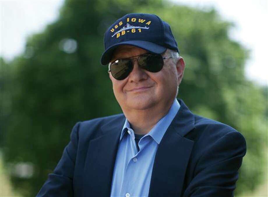 "This 2010 image released by G.P. Putnam Sons shows author Tom Clancy in Huntingtown, Md. Clancy, the bestselling author of ""The Hunt for Red October"" and other wildly successful technological thrillers, has died. He was 66. Penguin Group (USA) said Wednesday that Clancy died Tuesday in Baltimore. The publisher did not disclose a cause of death. (AP Photo/G.P. Putnam Sons, David Burnett) Photo: David Burnett / G.P. Putnam Sons"