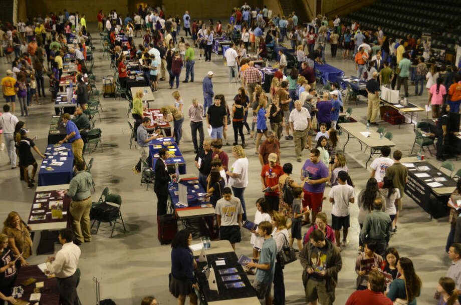 Area high school students, junior high students and parents talk with college recruiters from across Texas and the nation Wednesday evening at the college forum at the MC Chaparral Center. Tim Fischer\Reporter-Telegram Photo: Tim Fischer