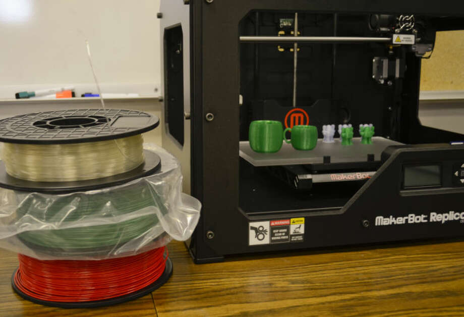 The MakerBot 3D printer uses spools of plastic wire to melt and print objects. Tim Fischer\Reporter-Telegram Photo: Tim Fischer