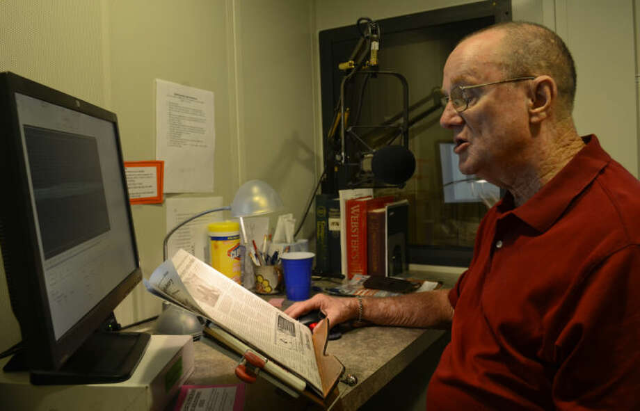 Jack Mangan, volunteer reader, records the daily newspaper Tuesday at the Recording Library of West Texas. Tim Fischer\Reporter-Telegram Photo: Tim Fischer