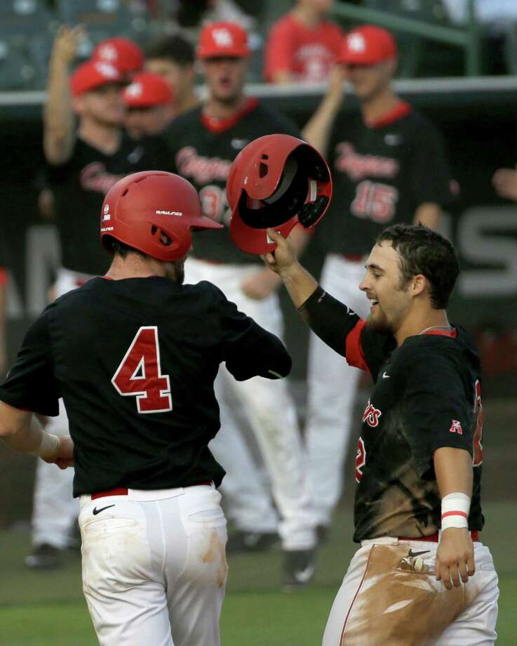 University of Houston Zac Taylor, left, and Michael Pyeatt, right, celebrate scoring against Rice University during the fourth inning of baseball game in Reckling Park at Rice Tuesday, May 10, 2016, in Houston. Photo: Melissa Phillip, Houston Chronicle / © 2016 Houston Chronicle