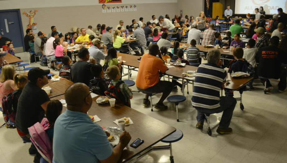 Hundreds of fathers, grandfathers, uncles or big brothers fill the cafetaria at Lamar Elementary Thursday morning during the All Pro Dad's Breakfast. Tim Fischer\Reporter-Telegram Photo: Tim Fischer