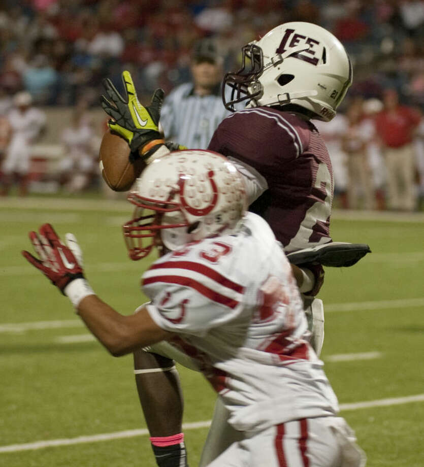 Lee High's Aron Dobbins pulls in a reception as Odessa High's Edgar Contreras defends Friday night at Grande Communications Stadium. Tim Fischer\Reporter-Telegram Photo: Tim Fischer