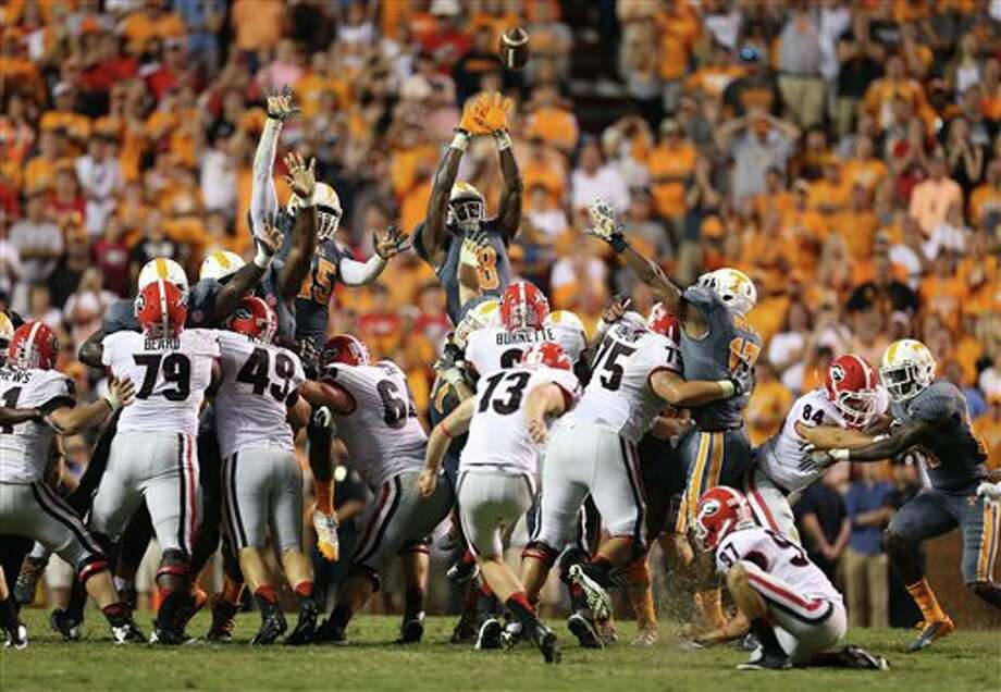 Tennessee's A.J. Johnson (45) and Marquez North (8) attempt to block a 42-yard field goal by Georgia's Marshall Morgan (13) during an NCAA college football game in Knoxville, Tenn., Oct. 5, 2013. (AP Photo/Atlanta Journal-Constitution, Jason Getz) Photo: Jason Getz / Atlanta Journal-Constitution
