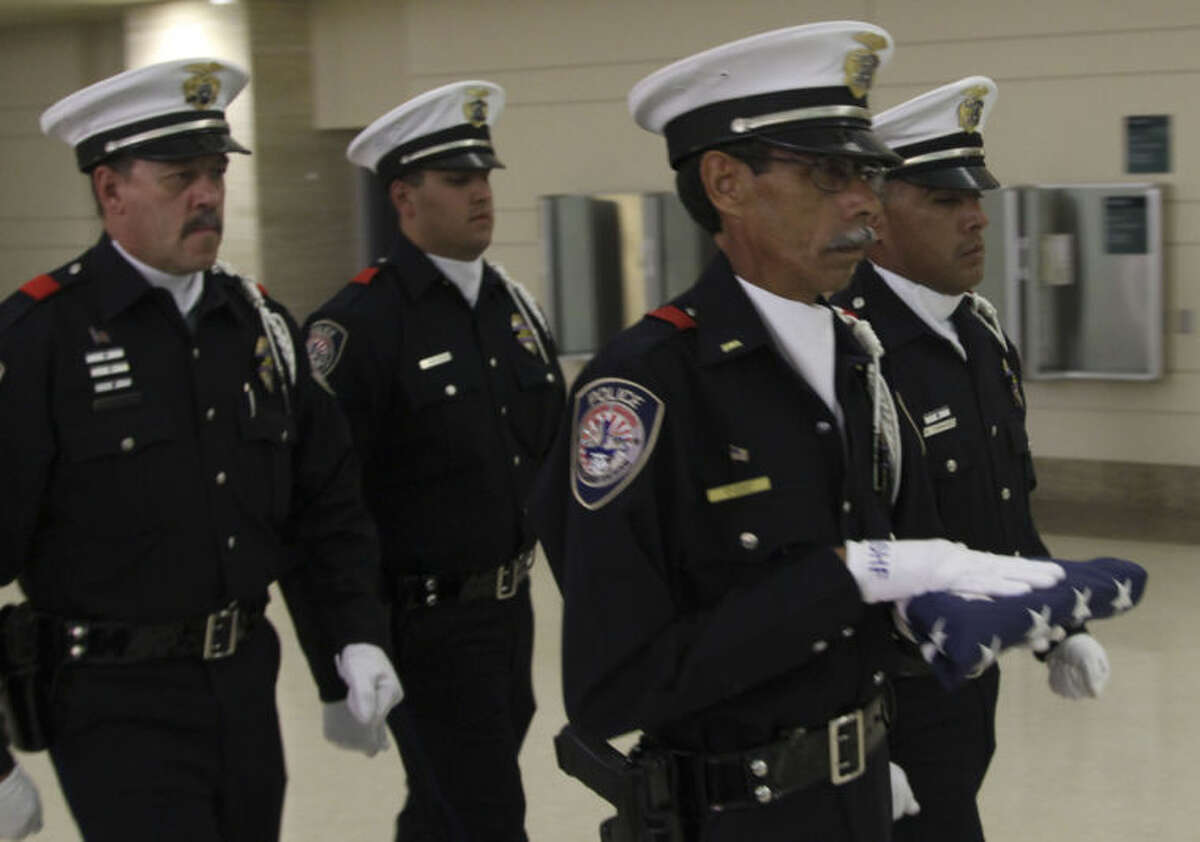 From left to right: MPD Officer Loren Frost, Officer Eluid Amparan, Lt. Victor Rivera and Officer Marcus Dominguez transport the U.S. Honor Flag Sunday night at Midland International Airport. Tyler White/Reporter-Telegram