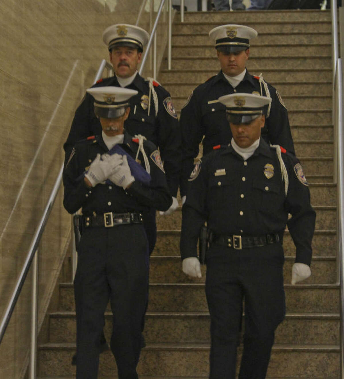 From left to right: MPD Officer Loren Frost, Lt. Victor Rivera, Officer Eluid Amparan, and Officer Marcus Dominguez transport the U.S. Honor Flag Sunday night at Midland International Airport. Tyler White/Reporter-Telegram