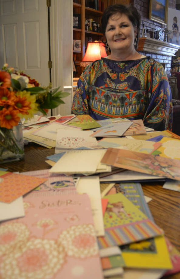 Lisa Zachry, cancer survivor, displays the get well cards she received from friends and family while in the hospital. Tim Fischer\Reporter-Telegram Photo: Tim Fischer