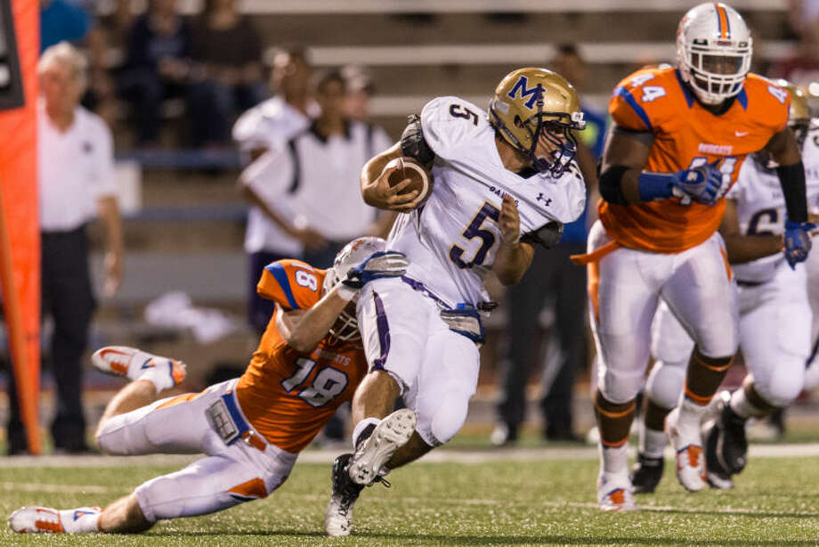 San Angelo Central defensive end Levi Haynes (18) snags Midland High running back Lance White for a loss Oct. 5 at San Angelo Stadium. Arthur Spragg/Special to the MRT Photo: Arthur Spragg