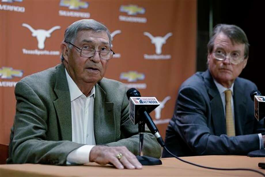 Texas athletic director DeLoss Dodds, left, with Texas president Bill Powers, right, formally announces his retirement during a news conference, Tuesday, Oct. 1, 2013, in Austin, Texas. Dodds, who has been with Texas for 32 years, will step down in August 2014. (AP Photo/Eric Gay) Photo: Eric Gay / AP