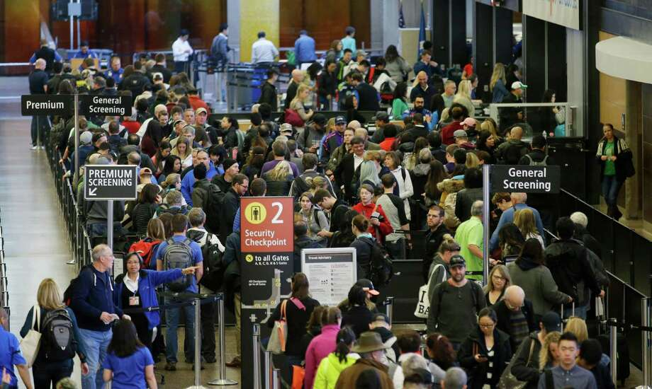 In this March 17, 2016, photo, travelers wait in line for security screening at Seattle-Tacoma International Airport in Seattle. Fliers will likely face massive security lines at airports across the country this summer, with airlines already warning passengers to arrive at least two hours early or risk missing their flight. (AP Photo/Ted S. Warren) Photo: Ted S. Warren, STF / Copyright 2016 The Associated Press. All rights reserved. This material may not be published, broadcast, rewritten or redistribu