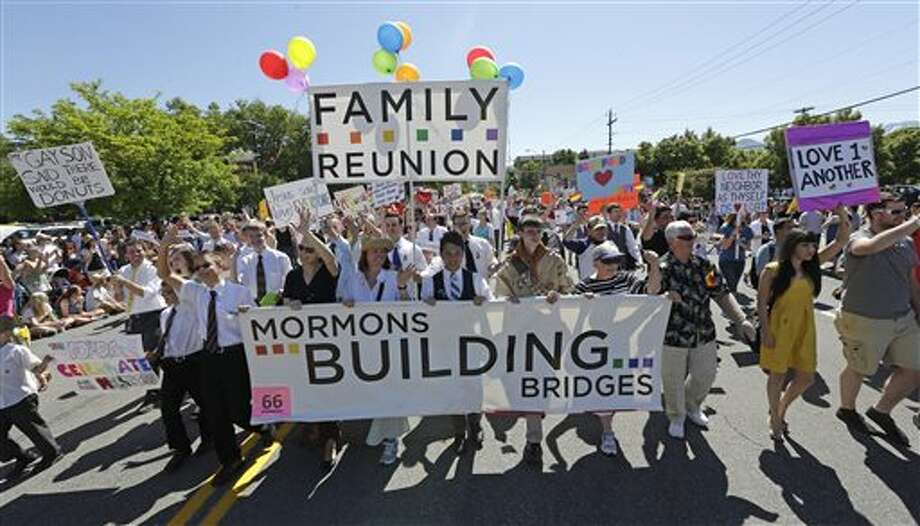 FILE - In this June 2, 2013 file photo, members of the Mormons Building Bridges march during the Utah Gay Pride Parade in Salt Lake City. The Mormon church's stance on homosexuality has softened considerably since it was one of the leading forces behind California's Proposition 8. (AP Photo/Rick Bowmer, File) Photo: Rick Bowmer / AP