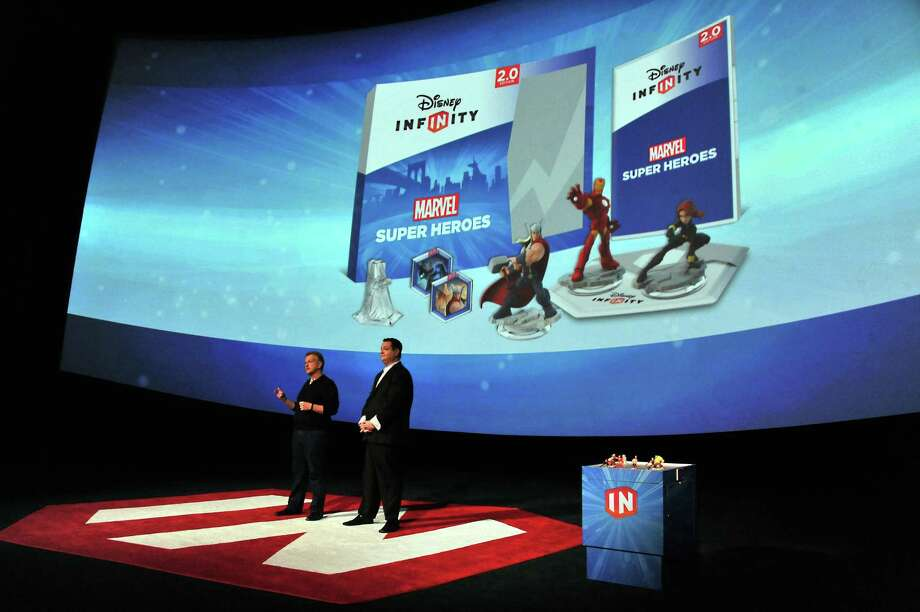 Disney officials speak at the Disney Infinity 2.0 launch in Hollywood in 2014.  Disney said Tuesday it is shutting down its Infinity line of video games, saying the changing market is too risky.  Photo: Katy Winn, INVL / Invision