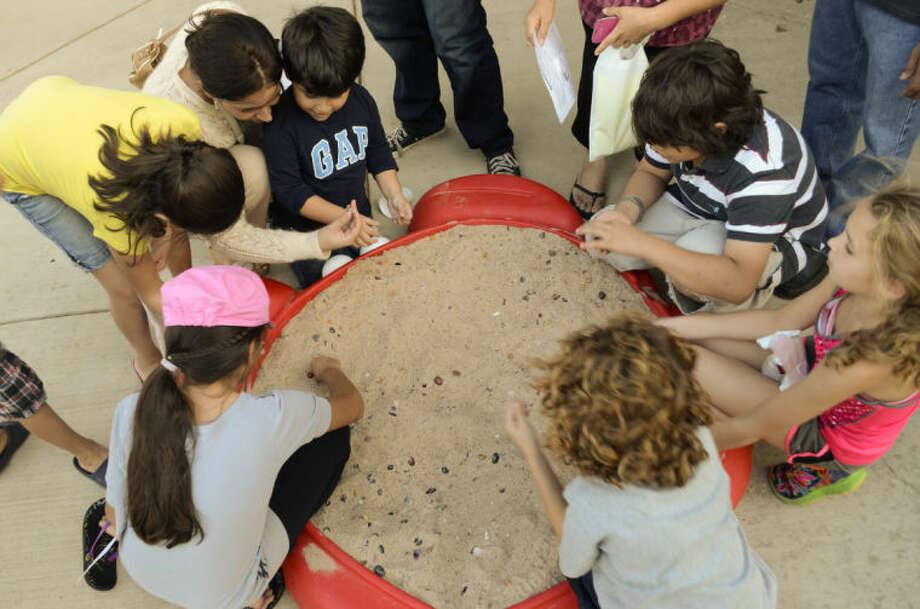 Children search for gems in a sandbox Thursday evening during Family Science Night at the Petroleum Museum. Tim Fischer\Reporter-Telegram Photo: Tim Fischer