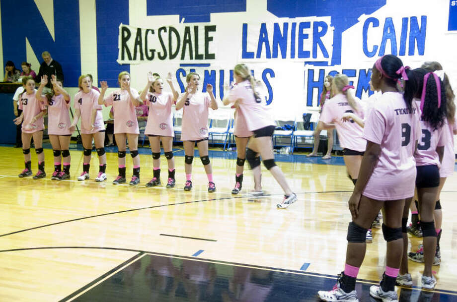 "Trinity's volleyball team lines up before the first match against Midland Classical during Trinity's ""Dig Pink"" game for breast cancer awareness Tuesday at Trinity. James Durbin/Reporter-Telegram Photo: JAMES DURBIN"