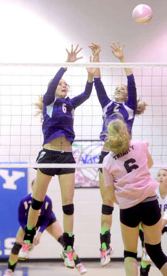 "Midland Classical's McKenzie Griffin (6) and Lexi Watts (2) try to block a hit from Trinity during Trinity's ""Dig Pink"" game for breast cancer awareness Tuesday at Trinity. James Durbin/Reporter-Telegram Photo: JAMES DURBIN"