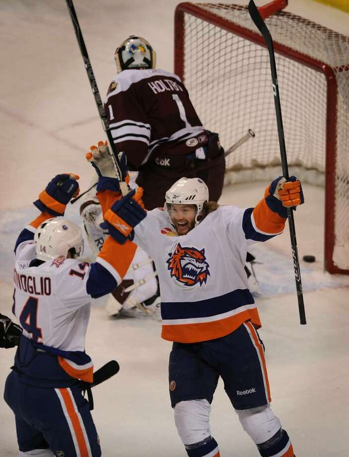 Sound Tigers Sean Bentivoglio, left, and Robin Figren celebrate Bentivoglio's first period goal during Sunday's East Division semi-final game with Hershey, PA, at the Arena at Harbor Yard in Bridgeport. Photo: Brian A. Pounds / Connecticut Post
