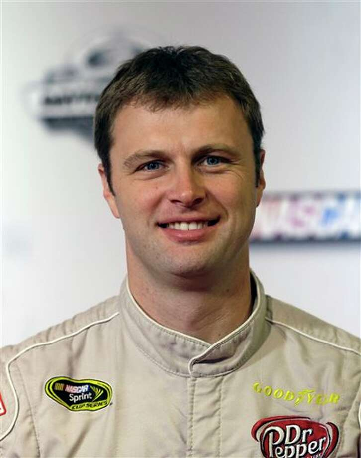 In this Feb. 14, 2013, photo, Travis Kvapil poses for a photo during media day at Daytona International Speedway in Daytona Beach, Fla. Kvapil is free on bond following his arrest on charges of assault and false imprisonment. A statement from the Mooresville (N.C.) Police Department said officers responded to a 911 call from the Kvapil residence on Tuesday, Oct. 8, 2013. After an investigation, police said they arrested the 37-year-old Kvapil in connection with a domestic dispute between him and his wife. No further details were provided. (AP Photo/John Raoux Photo: John Raoux / AP