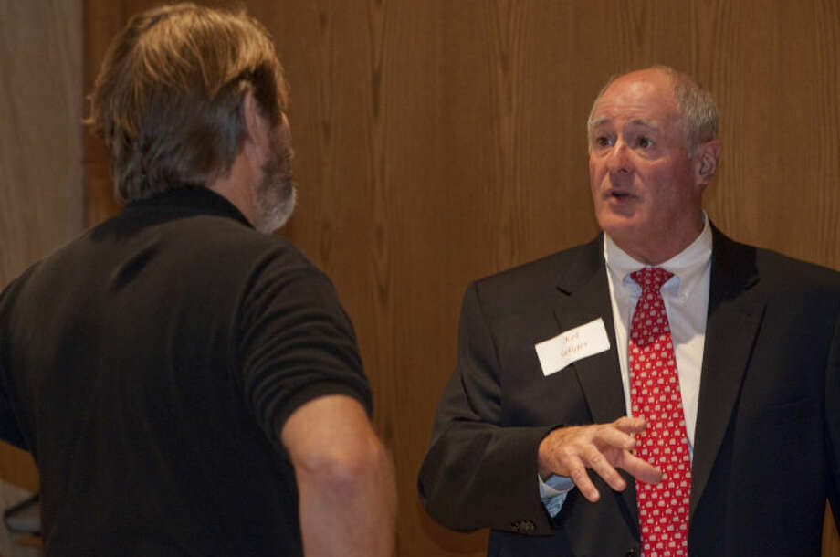 Senator Kel Seliger talks with Buddy White, husband of mayoral candidate Kathy White, Wednesday afternoon before the Midland County Republican Women's luncheon. Tim Fischer\Reporter-Telegram Photo: Tim Fischer