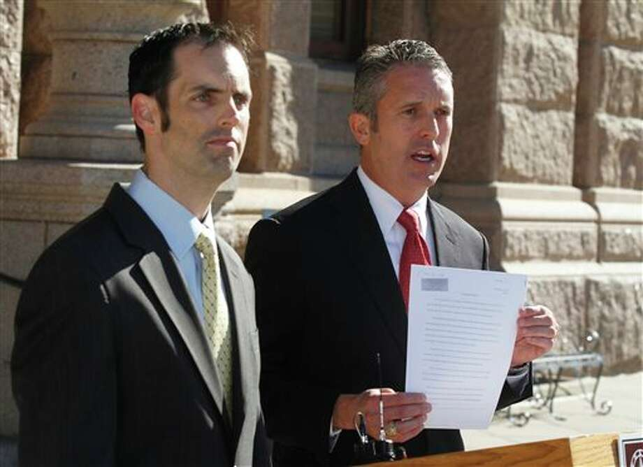 Texas Center for Defense of Life chief counsel Stephen Casey, left, and group president Greg Terra announce, from the Capitol steps in Austin, Texas on Wednesday, Oct. 9, 2013, that they are suing an ex-Texas judge who ordered a 15-year-old girl to be returned to a home where she claimed her legal guardian's sex-offender boyfriend made aggressive advances and tried to force her to terminate a pregnancy. The anti-abortion group charges former state District Judge Terrill L. Flenniken with knowingly placing the minor with her former step grandmother, even though she lived with a registered sex offender in Caldwell, northeast of Austin. When the victim became pregnant by her 15-year-old boyfriend she said she didn't want to have an abortion but that her guardian and the boyfriend pressured her to. (AP Photo/Jack Plunkett) Photo: Jack Plunkett / FR59553 AP