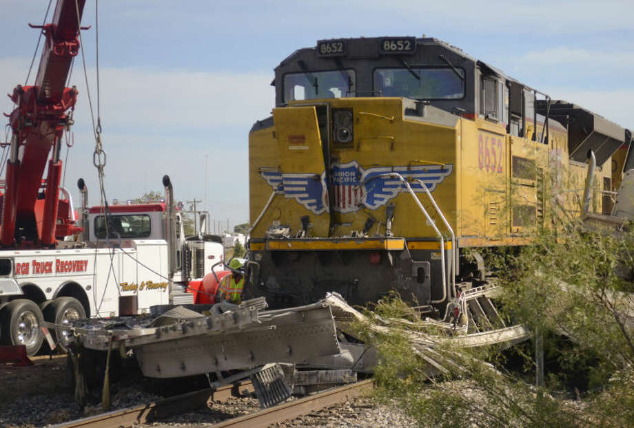 No one was injured after a semi and trailer were hit by a train Wednesday morning off E. Highway 80 near Loop 250. Tim Fischer\Reporter-Telegram Photo: Tim Fischer