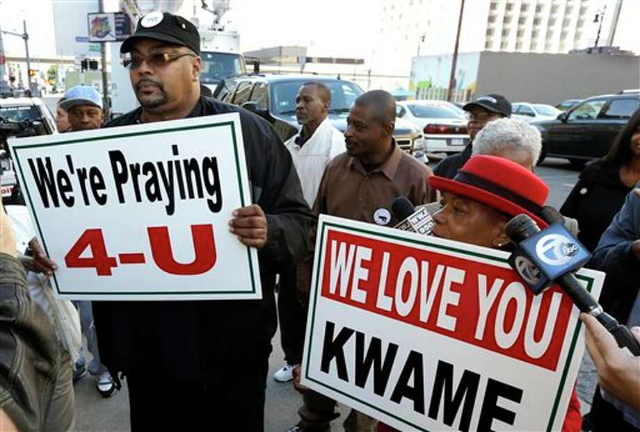 Malik Shabazz, left, and Wanda Redmond show their support for former Detroit Mayor Kwame Kilpatrick outside federal court in Detroit, Thursday, Oct. 10, 2013. Kilpatrick was sentenced Thursday to 28 years in prison, one of the longest recent punishments for public corruption in the United States. (AP Photo/Carlos Osorio) Photo: Carlos Osorio / AP