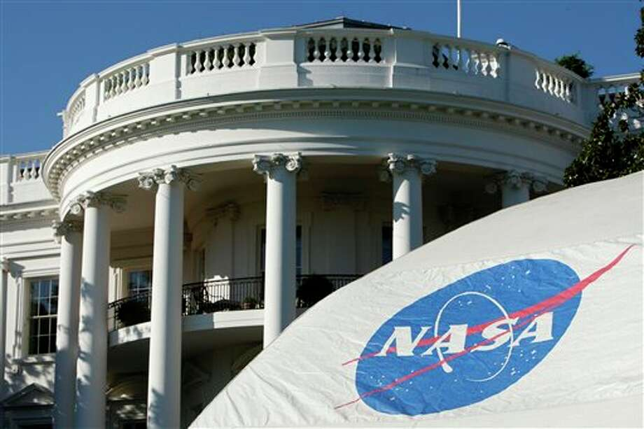 FILE - This Oct. 7, 2009 file photo shows a NASA tent is erected on the South Lawn of the White House in Washington in preparation of an event with the President Barack Obama and first lady Michelle Obama who will be joined by local area middle school students as the use telescopes to star gaze. NASA may have the Right Stuff, but it's not essential. In fact, of all the larger government agencies, NASA is sending the largest percentage home in the government shutdown because they are considered not essential. On the opposite end of the spectrum, the Veterans Administration, which usually doesn't grab attention unless something goes wrong, has one of the highest percentage of workers considered essential and staying on. (AP Photo/Pablo Martinez Monsivais, File) Photo: Pablo Martinez Monsivais / AP