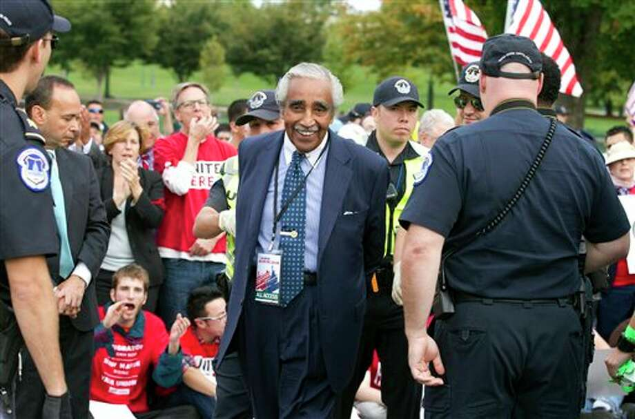 Rep. Charles Rangel, D-N.Y., is arrested by U.S. Capitol Police officers on Capitol Hill during a immigration rally in Washington, Tuesday, Oct. 8, 2013. ( AP Photo/Jose Luis Magana) Photo: Jose Luis Magana / FR159526 AP