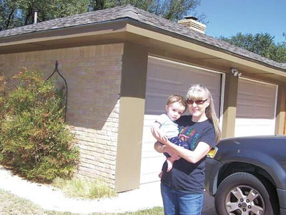 Trish Stump and her great-grandson Braxton are pleased with the way Monty Wheeler of WBC Custom Homes fixed Trish's home after a previous contractor left the job in a shambles. For repairs, remodeling or new home construction, call Monty at 432-638-5227.