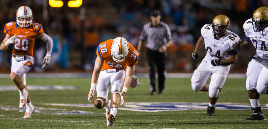 Arthur Spragg/Special to the Standard-Times Central High School linebacker Davis Martin scoops up a Midland High fumble and returns it for a touchdown Friday at San Angelo Stadium. Photo: Arthur_Spragg