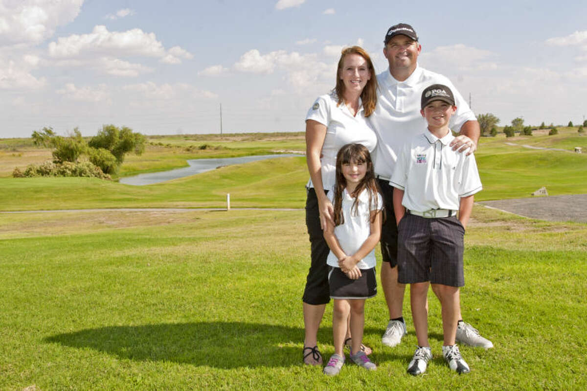 Shawn and Jennifer Mehan stand with their children, Julianne, age 5 and Kyle, age 9, at Ratliff Ranch Golf Course on Saturday. Kyle Mehan raised $15,000 for Kids Play Fore Kids, an annual fundraising golf tournament put on by the Northern Texas PGA Junior Golf Foundation. James Durbin/Reporter-Telegram