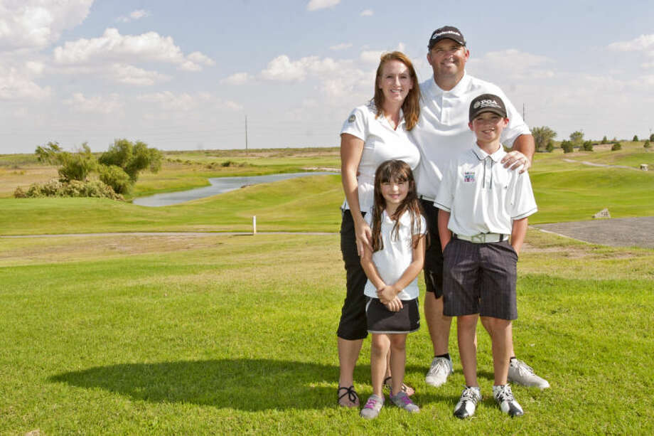 Shawn and Jennifer Mehan stand with their children, Julianne, age 5 and Kyle, age 9, at Ratliff Ranch Golf Course on Saturday. Kyle Mehan raised $15,000 for Kids Play Fore Kids, an annual fundraising golf tournament put on by the Northern Texas PGA Junior Golf Foundation. James Durbin/Reporter-Telegram Photo: JAMES DURBIN