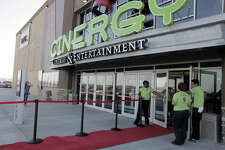 Cinergy Cinema employees greet patrons during the theater's grand opening celebration.