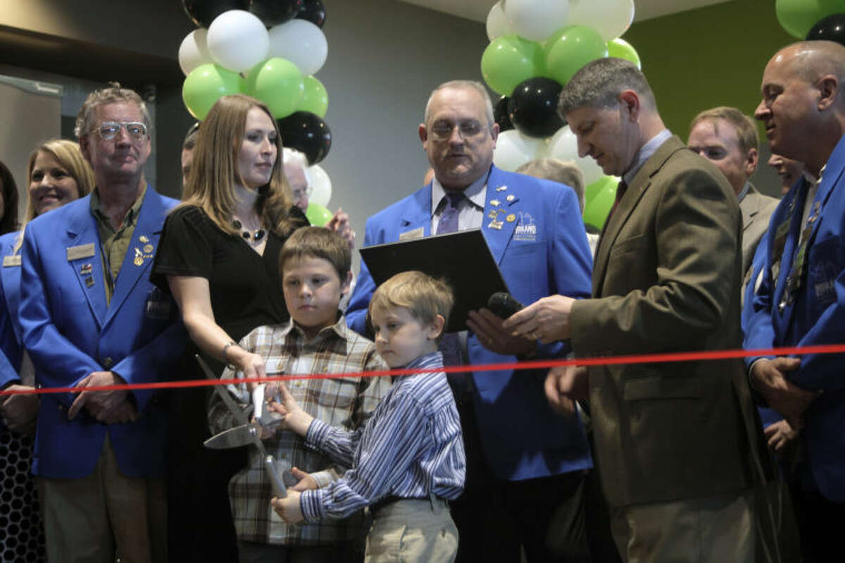 Members of the Benson family and the Midland Chamber of Commerce participate in the ribbon cutting ceremony during Cinergy Cinema's grand opening.