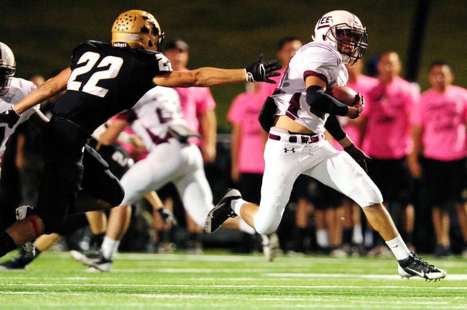 Joy Lewis/Reporter-News Midland Lee defensive back Abel Sanchez (27) escapes Abilene High linebacker Hill Holloway (22) during the first half of their game Friday, October 11, 2013 at Shotwell Stadium. Photo: Joy Lewis