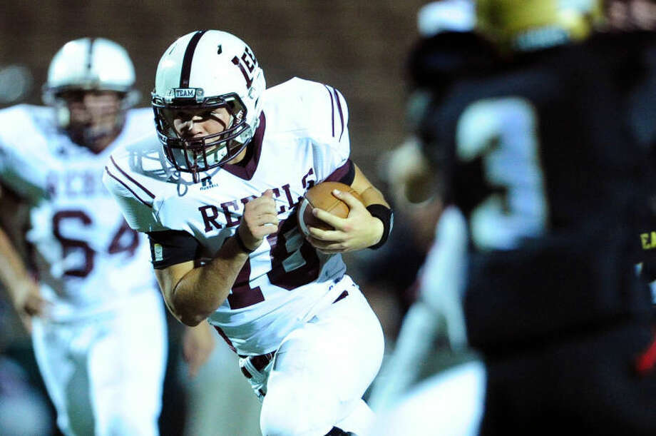 Joy Lewis/Reporter-News Midland Lee quarterback Caden Coots pushes through Abilene High defense during their their game Friday, October 11, 2013 at Shotwell Stadium. Photo: Joy Lewis