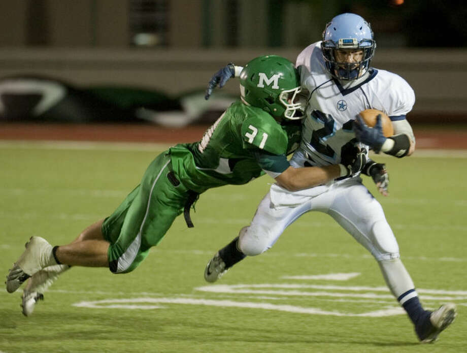 Monahans' Kristian Crozier dives to bring down Greenwood's Braydin Moreland Friday evening in Monahans. Tim Fischer\Reporter-Telegram Photo: Tim Fischer