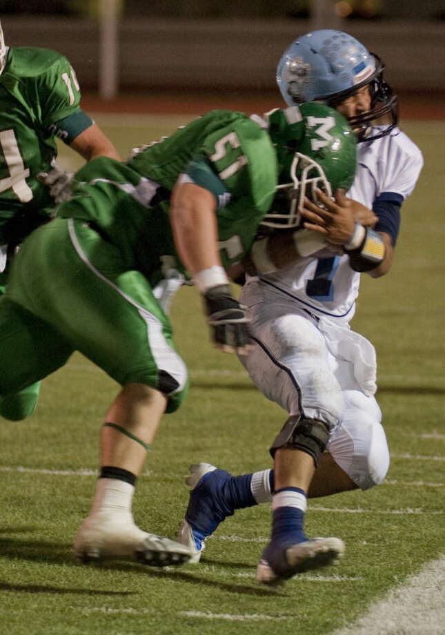 Greenwood's Anthony Salas takes a hit from Monahans' Stephan Self Friday evening in Monahans. Tim Fischer\Reporter-Telegram Photo: Tim Fischer