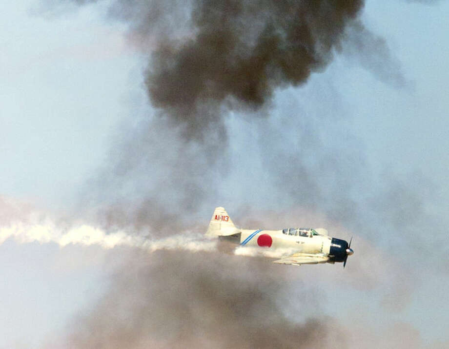 A Japanese Zero replica performs during the Commemorative Air Force AirSho 2013 at Midland International Aiport. James Durbin/Reporter-Telegram Photo: JAMES DURBIN