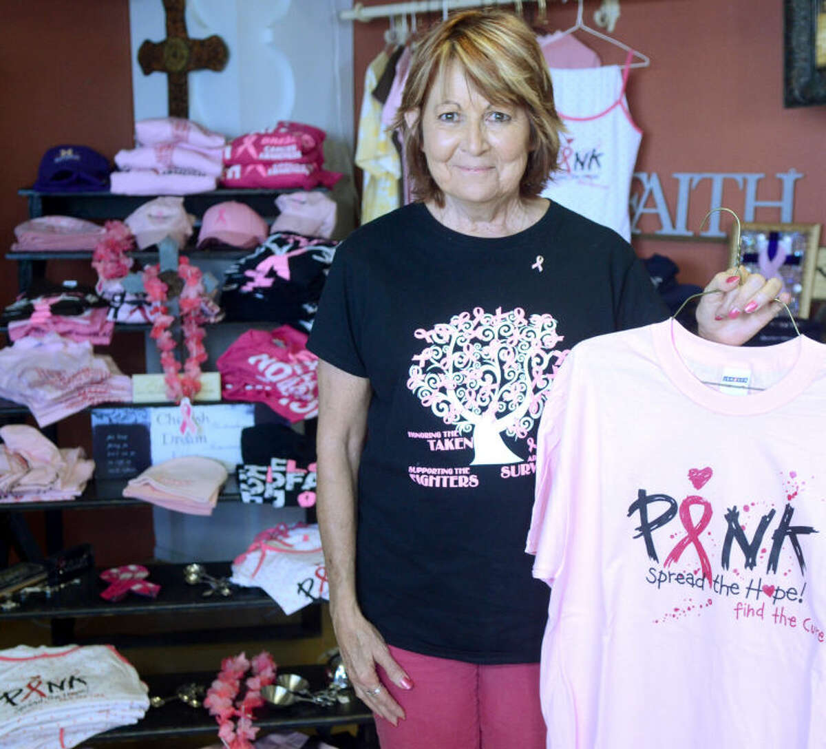 Cherrie Wilson, owner of Kyotee Screen Printing and a breast cancer survivor, is making T-shirts to benefit the Hope House. James Durbin/Reporter-Telegram