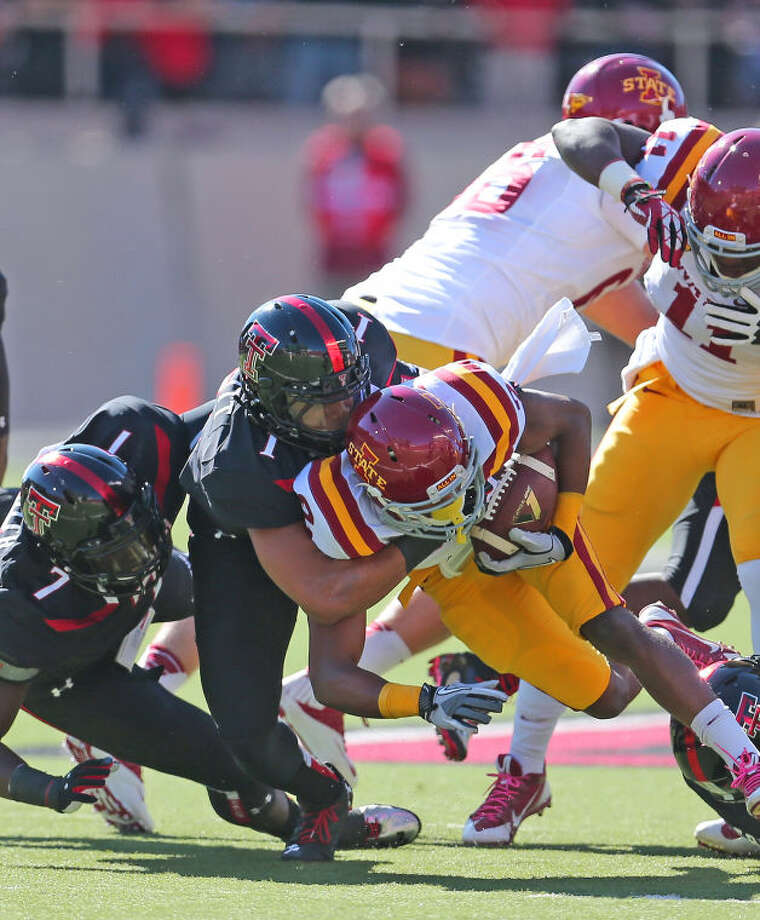 Tech defender Terrance Bullitt (1) corrals Iowa State running back Aaron Wimberly (2) in Saturday's Big 12 action at Jones AT&T Stadium. The Red Raiders went on to defeat the Cyclones 42-35 to improve their record to 6-0. Wade H. Clay/Special to the MRT Photo: Wade H Clay