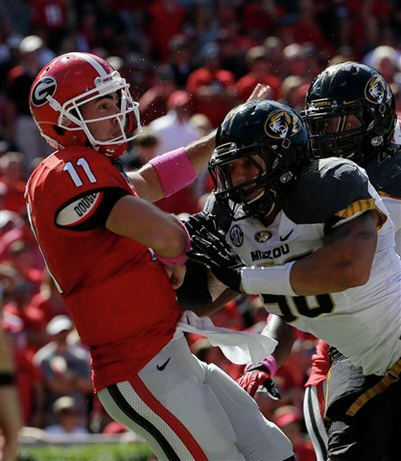 Georgia quarterback Aaron Murray (11)is hit by Missouri defensive lineman Ben Eskelson (58)as he releases a pass in the second half of an NCAA college football game Saturday, Oct. 12, 2013 in Athens, Ga., Missouri won 41-26. (AP Photo/John Bazemore) Photo: John Bazemore / AP