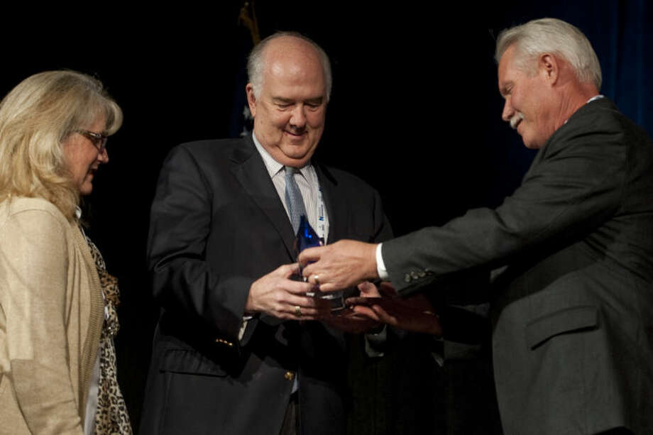 Fred Callon is presented with the Bruno Hanson/Midland College Environmental Excellence Award by Hoxie Smith and Gretchen Bakke Monday evening at the 17th annual Hearst Energy Awards. Tim Fischer\Reporter-Telegram Photo: Tim Fischer