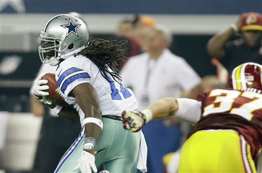 Dallas Cowboys wide receiver Dwayne Harris (17) escapes a tackle attempt by Washington Redskins' Reed Doughty (37) on a punt return in the second half of an NFL football game, Sunday, Oct. 13, 2013, in Arlington, Texas. (AP Photo/Tim Sharp) Photo: Tim Sharp / FR62992 AP