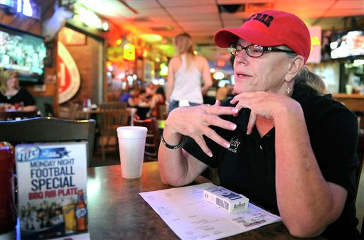 In this Monday, Sept. 23, 2013 photo, Judy Farris, general manager of The Bar, in Midland, Texas, talks about the current oil boom. The boom has largely been ushered in by new hydraulic fracturing technologies combined with horizontal drilling. (AP Photo/Pat Sullivan)