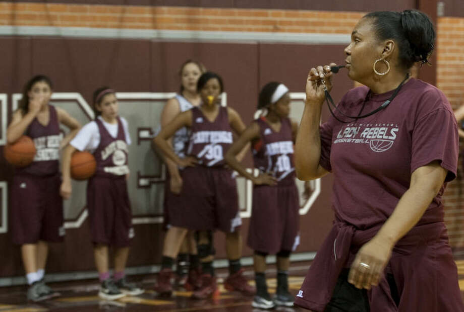 Lee girls basketball coach Monica Ramirez works with her girls Wednesday on the first day of practice for the season. Tim Fischer\Reporter-Telegram Photo: Tim Fischer