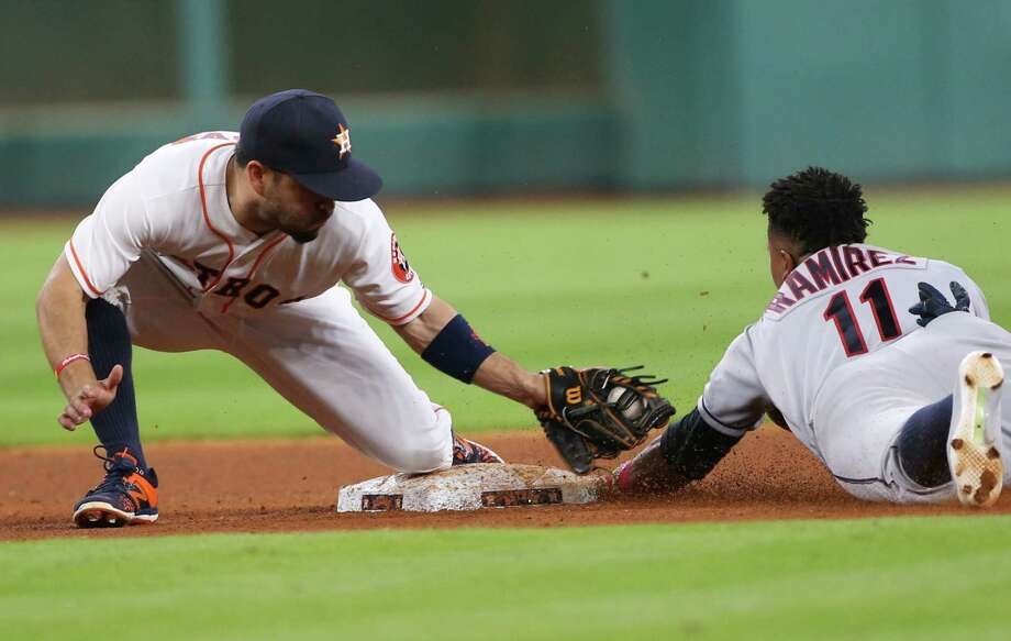 The Astros get a favorable call as second baseman Jose Altuve, left, puts what appears to be a late tag on the Indians' Jose Ramirez, who was called out on a steal attempt. Photo: Elizabeth Conley, Staff / © 2016 Houston Chronicle